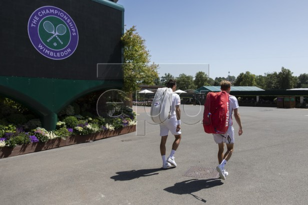 Roger Federer of Switzerland, left, and David Goffin of Belgium on their way to a training session at the All England Lawn Tennis Championships in Wimbledon, London, on Thursday, June 27, 2019. EPA-EFE/PETER KLAUNZER EDITORIAL USE ONLY; NO SALES, NO ARCHIVES