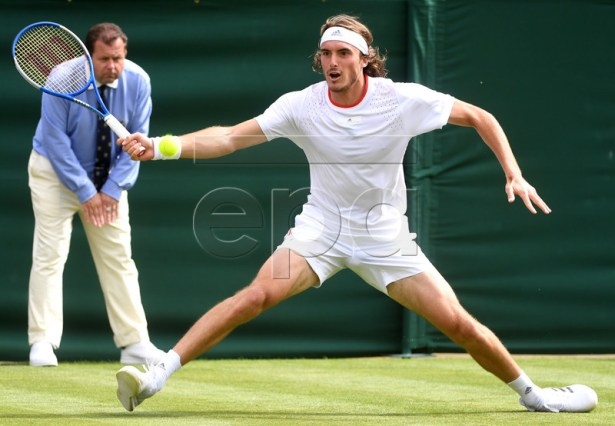 Stefanos Tsitsipas of Greece in action against Thomas Fabbiano of Italy during their first round match at the Wimbledon Championships at the All England Lawn Tennis Club, in London, Britain, 01 July 2019. EPA-EFE/FACUNDO ARRIZABALAGA EDITORIAL USE ONLY/NO COMMERCIAL SALES