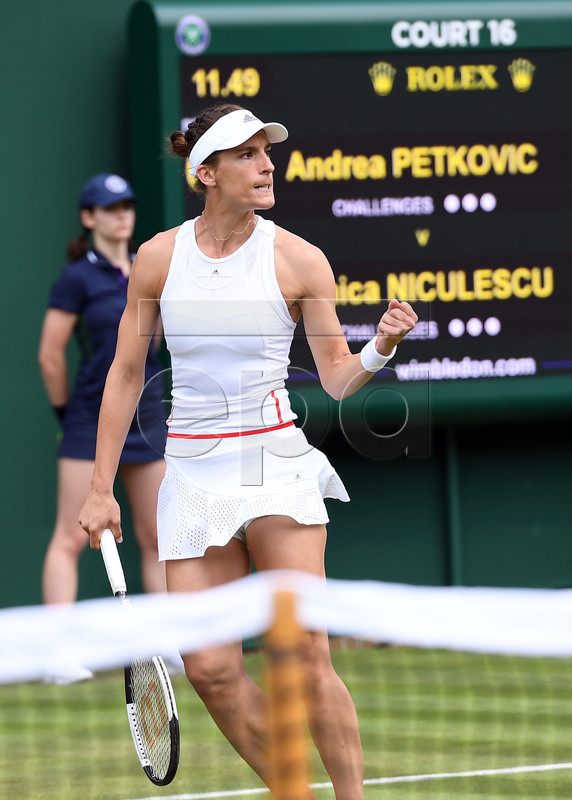 Andrea Petkovic of Germany scores against Monica Niculescu of Romania in their first round match during the Wimbledon Championships at the All England Lawn Tennis Club, in London, Britain, 02 July 2019. EPA-EFE/ANDY RAIN EDITORIAL USE ONLY/NO COMMERCIAL SALES
