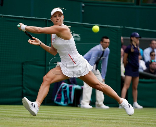 Angelique Kerber of Germany returns to compatriot Tatjana Maria in their first round match during the Wimbledon Championships at the All England Lawn Tennis Club, in London, Britain, 02 July 2019. EPA-EFE/WILL OLIVER EDITORIAL USE ONLY/NO COMMERCIAL SALES