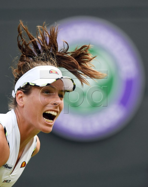 Johanna Konta of Britain serves to Ana Bogdan of Romania in their first round match during the Wimbledon Championships at the All England Lawn Tennis Club, in London, Britain, 02 July 2019. EPA-EFE/FACUNDO ARRIZABALAGA EDITORIAL USE ONLY/NO COMMERCIAL SALES