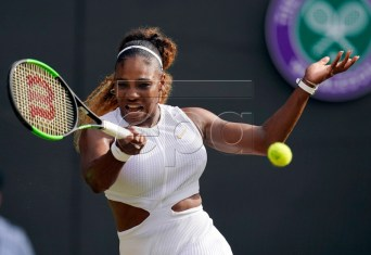 Serena Williams of the US returns to Kaja Juvan of Slovenia in their second round match during the Wimbledon Championships at the All England Lawn Tennis Club, in London, Britain, 04 July 2019. EPA-EFE/WILL OLIVER EDITORIAL USE ONLY/NO COMMERCIAL SALES