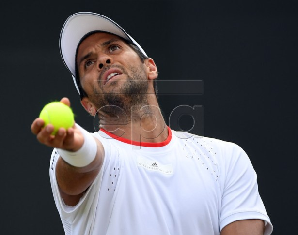 Fernando Verdasco of Spain serves to Thomas Fabbiano of Italy in their third round match during the Wimbledon Championships at the All England Lawn Tennis Club, in London, Britain, 05 July 2019. EPA-EFE/FACUNDO ARRIZABALAGA EDITORIAL USE ONLY/NO COMMERCIAL SALES