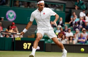 Roger Federer of Switzerland returns to Lucas Puille of France in their third round match during the Wimbledon Championships at the All England Lawn Tennis Club, in London, Britain, 06 July 2019. EPA-EFE/WILL OLIVER EDITORIAL USE ONLY/NO COMMERCIAL SALES