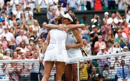 Johanna Konta of Britain (R) at the net with Petra Kvitova of the Czech Republic whom she defeated in their fourth round match during the Wimbledon Championships at the All England Lawn Tennis Club, in London, Britain, 08 July 2019. EPA-EFE/NIC BOTHMA EDITORIAL USE ONLY/NO COMMERCIAL SALES