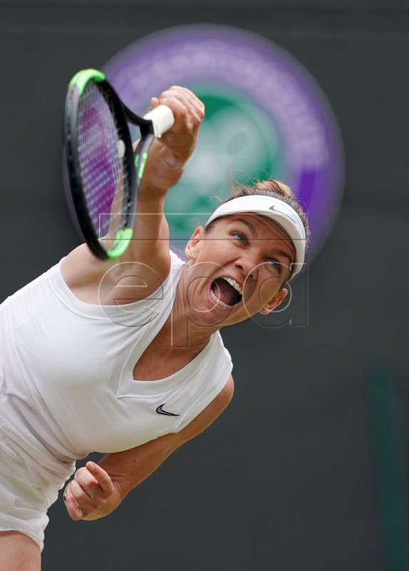 Simona Halep of Romania serves to Shuai Zhang of China in their quarter final match during the Wimbledon Championships at the All England Lawn Tennis Club, in London, Britain, 09 July 2019. EPA-EFE/WILL OLIVER EDITORIAL USE ONLY/NO COMMERCIAL SALES