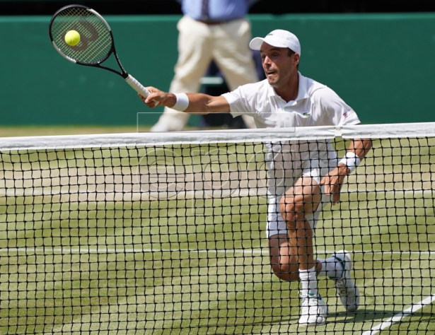 Roberto Bautista Agut of Spain returns to Novak Djokovic of Serbia in their semi final match during the Wimbledon Championships at the All England Lawn Tennis Club, in London, Britain, 12 July 2019. EPA-EFE/NIC BOTHMA EDITORIAL USE ONLY/NO COMMERCIAL SALES