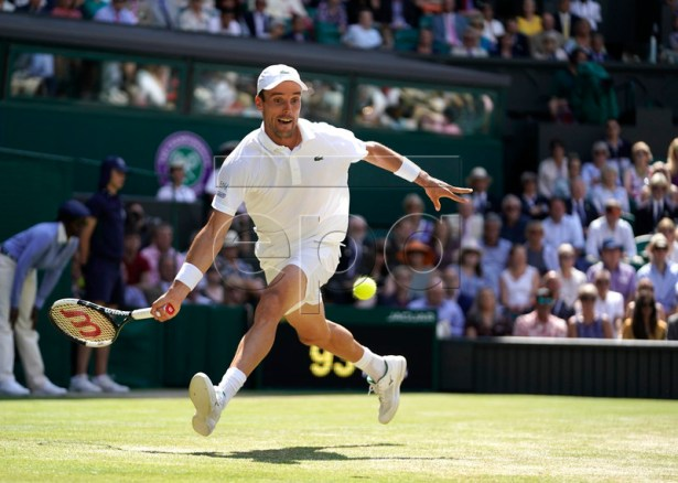 Roberto Bautista Agut of Spain in action against Novak Djokovic of Serbia during their semi final match for the Wimbledon Championships at the All England Lawn Tennis Club, in London, Britain, 12 July 2019. EPA-EFE/WILL OLIVER EDITORIAL USE ONLY/NO COMMERCIAL SALES