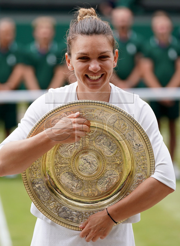 Simona Halep of Romania celebrates with the trophy after winning against Serena Williams of the USA during their final match for the Wimbledon Championships at the All England Lawn Tennis Club, in London, Britain, 13 July 2019. EPA-EFE/NIC BOTHMA EDITORIAL USE ONLY/NO COMMERCIAL SALES