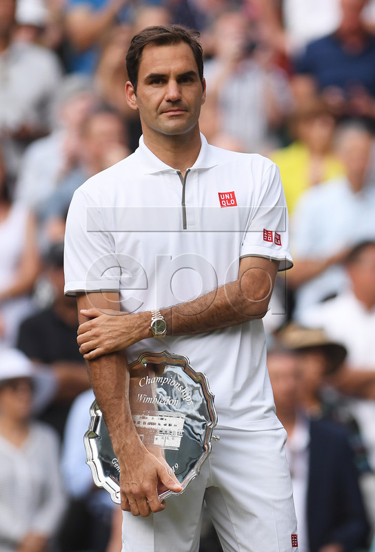Roger Federer of Switzerland reacts with the runner-up trophy after losing against Novak Djokovic of Serbia during their Men's final match for the Wimbledon Championships at the All England Lawn Tennis Club, in London, Britain, 14 July 2019. EPA-EFE/Laurence Griffiths / POOL EDITORIAL USE ONLY/NO COMMERCIAL SALES