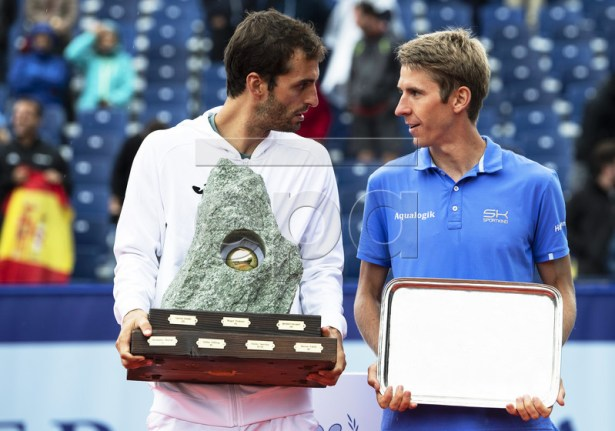 Albert Ramos-Vinolas (L) of Spain poses with the trophy after defeating Cedrik-Marcel Stebe (R) of Germany in their final match of the Swiss Open tennis tournament in Gstaad, Switzerland, 28 July 2019. EPA-EFE/PETER SCHNEIDER