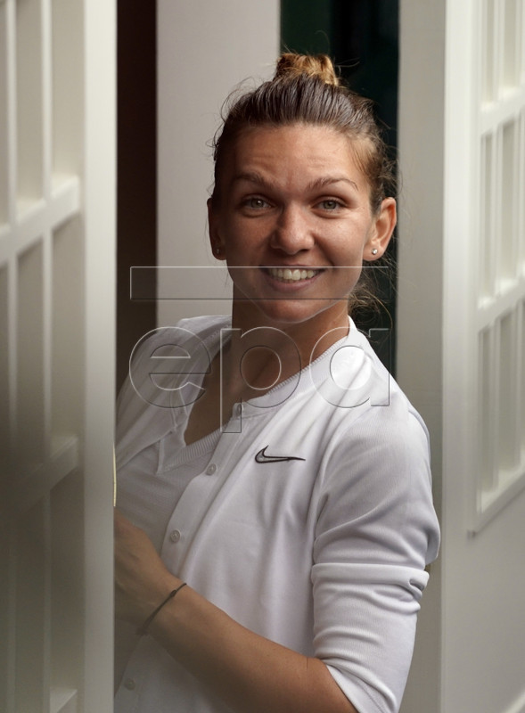 Simona Halep of Romania exits Centre Court with the championship trophy following her victory over Serena Williams of the US in the women's final of the Wimbledon Championships at the All England Lawn Tennis Club, in London, Britain, 13 July 2019. EPA-EFE/WILL OLIVER EDITORIAL USE ONLY/NO COMMERCIAL SALES