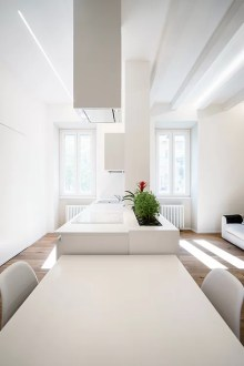 Minimalist apartment with all white interior in Rome by Brain     All white minimalist apartment with open space kitchen  dining and living  area in