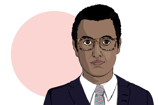 En medelålders man med mörkt hår, glasögon, kostym och slips.