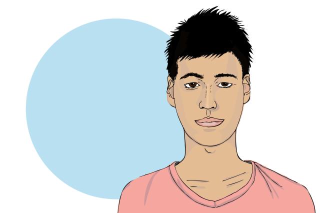 En ung kille med mörkt hår.