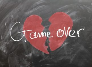 she's not the one -- A red broken heart on a black chalkboard
