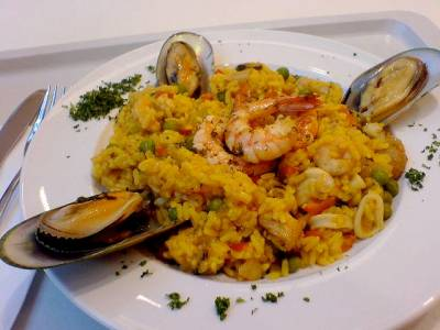 spectacular summer seafood dishesplate of paella deluxe foods rice, shrimp, and other seafood