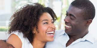 jamaican man and woman hugging smiling at each other