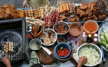 Lots of foods sold on the street by vendors in Thailand