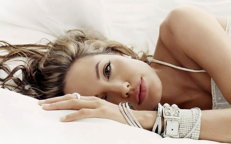 Angelina Jolie beautiful in bed lots of jewelry on