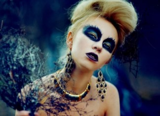 blonde haired woman with blue makeup