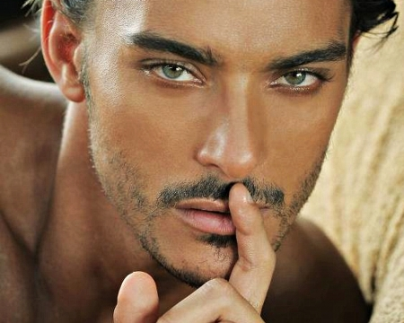 women say mature men don't do lies - good looking male holding finger to his lips