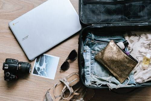 travel information - suitcase, glasses, laptop