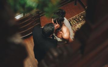 6 Easy Steps to Cure Vagina Dryness and Painful Sex couple kissing on their wedding night