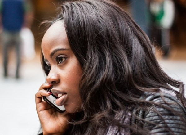it's time to breakup black woman on phone photo by Ehimetalor Unauabona Unsplash