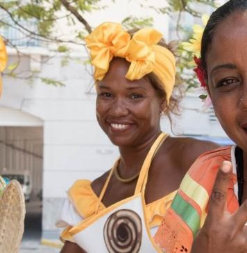 the three women in Cuba, cigars, and classic cars