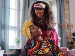 mother daughter looking down on mom with headwrap