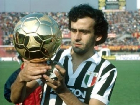 Michel Platini holding aloft the Ballon d'Or in Juventus colours in 1985.