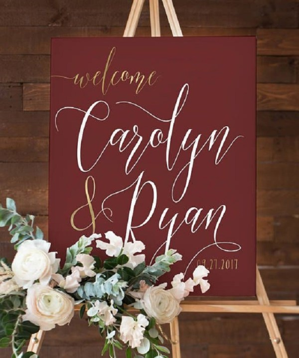 Burgundy sign boards with golden fonts