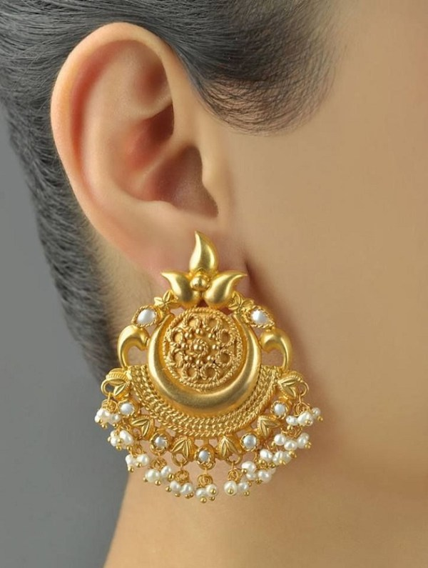 gold earrings on gorgeous bride