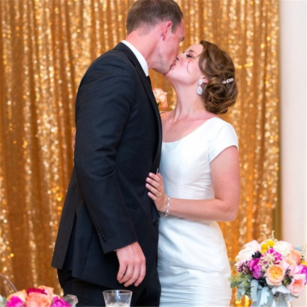 use Gold sequined fabric as backdrop and add colorful balloons