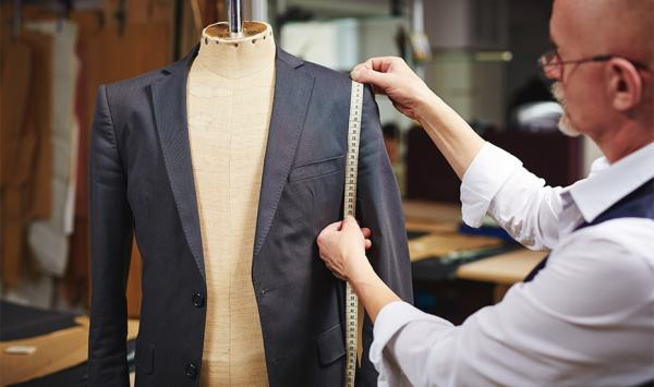 Groom's Suit fitting -123WeddingCards-min