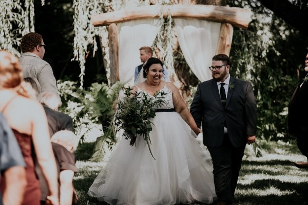 Courtney McMillion walked the aisle in her Jurassic Park theme