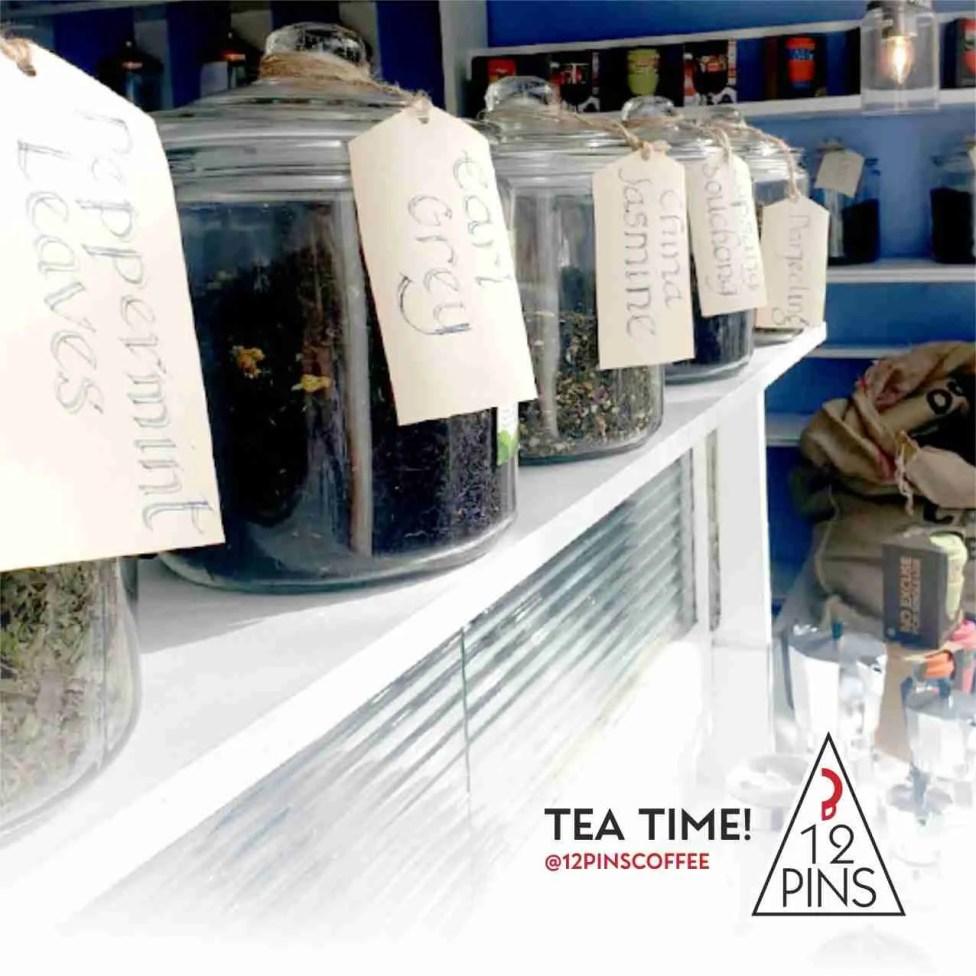 collection of loose leaf tea in jars