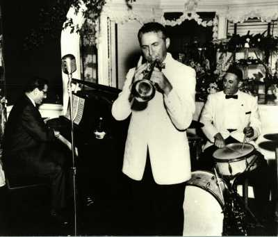 The Novack brothers, performing on July 4, 1956: Bob Novack on the piano, Paul Novak on the trumpet, and Lou Novak on the drums.