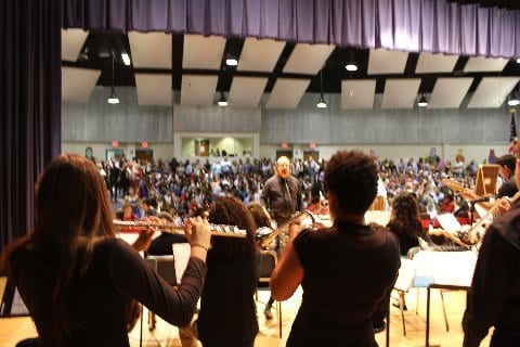 Ray Modia on stage conducting Nautilus Middle School orchestra