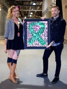 [Emily T. Nielsen &Amp; Tim Mcilrath (Of Rise Against) With The Original Art Piece That Started Rock Vs. Cancer, And Lead Into Punk Rock &Amp; Paintbrushes]