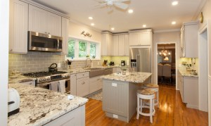 Winburn and Mason gutted their kitchen, which is now a bright space with marbled granite countertops, a spacious island and easy access to the adjacent dining room.