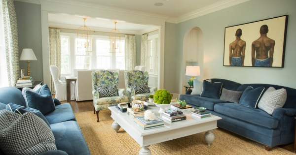 Shades of white and blue keep the living room feeling fresh and timeless.