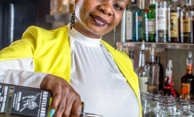 Thandi Walton prepares a mezcal cocktail.