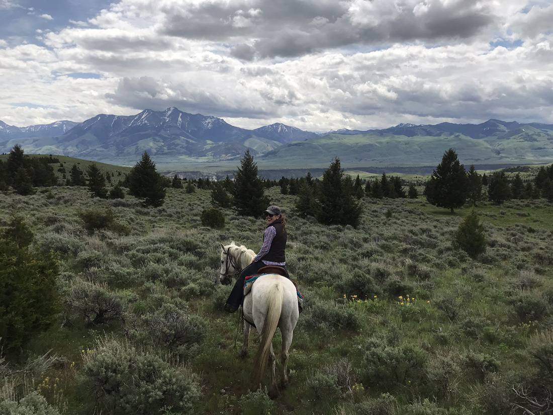 The author and her horse, Ivan, explore the ranch's rugged landscape.