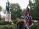 Man with confederate flad and AR-15 at general Lee statue