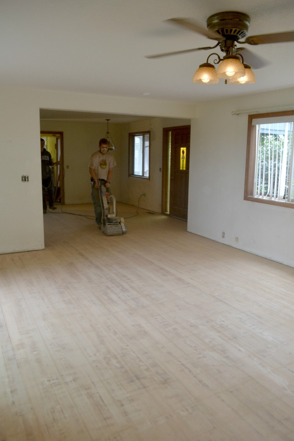 Using a floor sander to prep hardwood floor