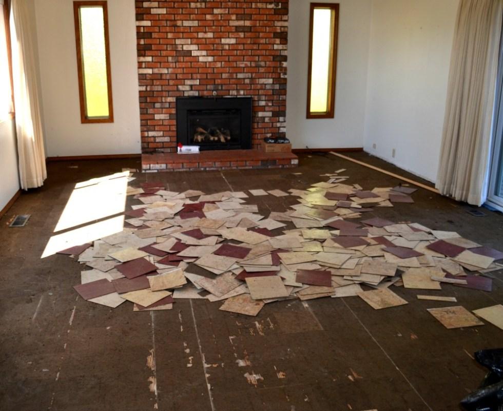 Making progress removing laminate tiles in prep for the hardwood floors below