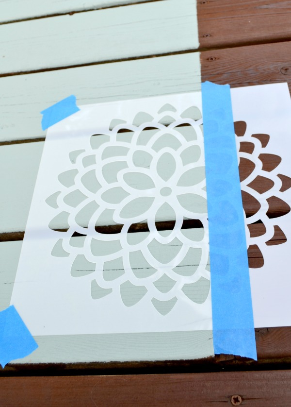 How to use a mum flower stencil to add a beautiful design to a painted rug on a deck or patio