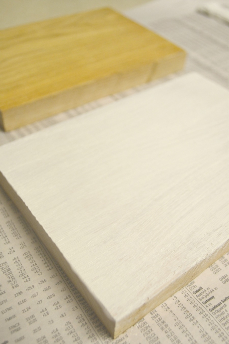 Scrap boards painted with one coat of white paint for a rustic look